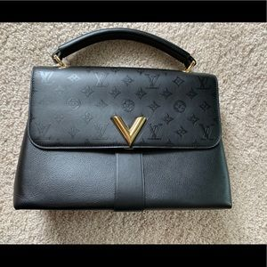 Louis Vuitton shoulder bag with tophandle